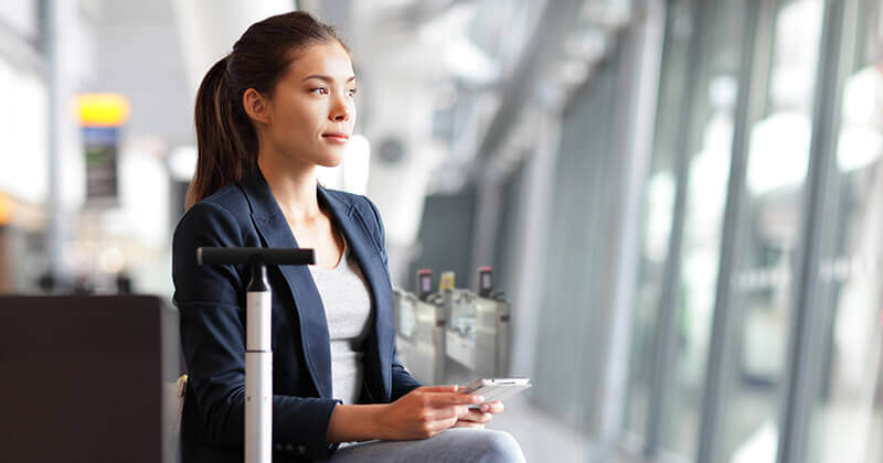 Woman at airport waiting for self-boarding