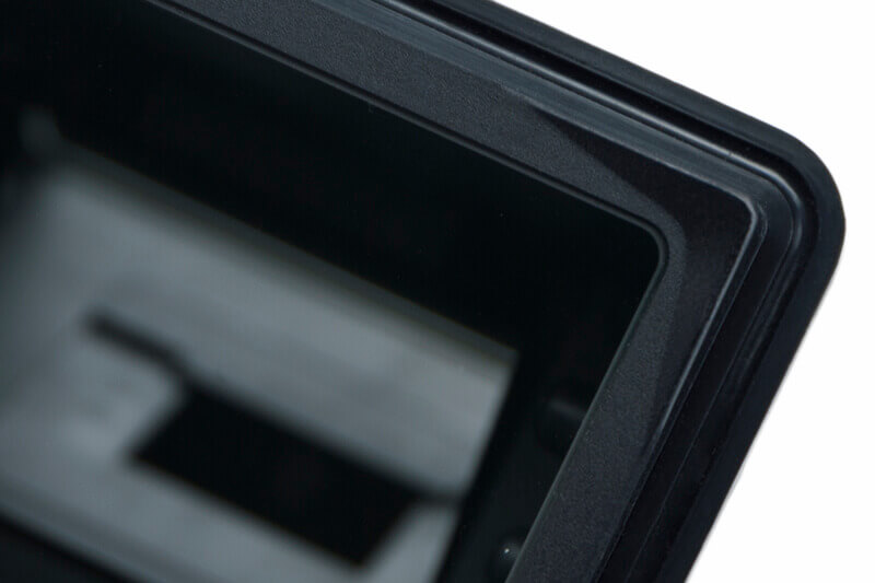 Corner release tab molded into reader